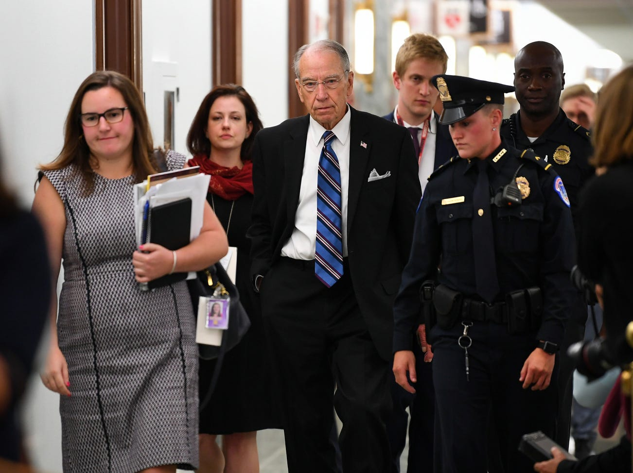 Senator Chuck Grassley, chairman of the Senate Judiciary Committee, walks into the hearing room following a 15 minute break as Supreme Court nominee Brett Kavanaugh testifies in front of the Senate Committee, Thursday.
