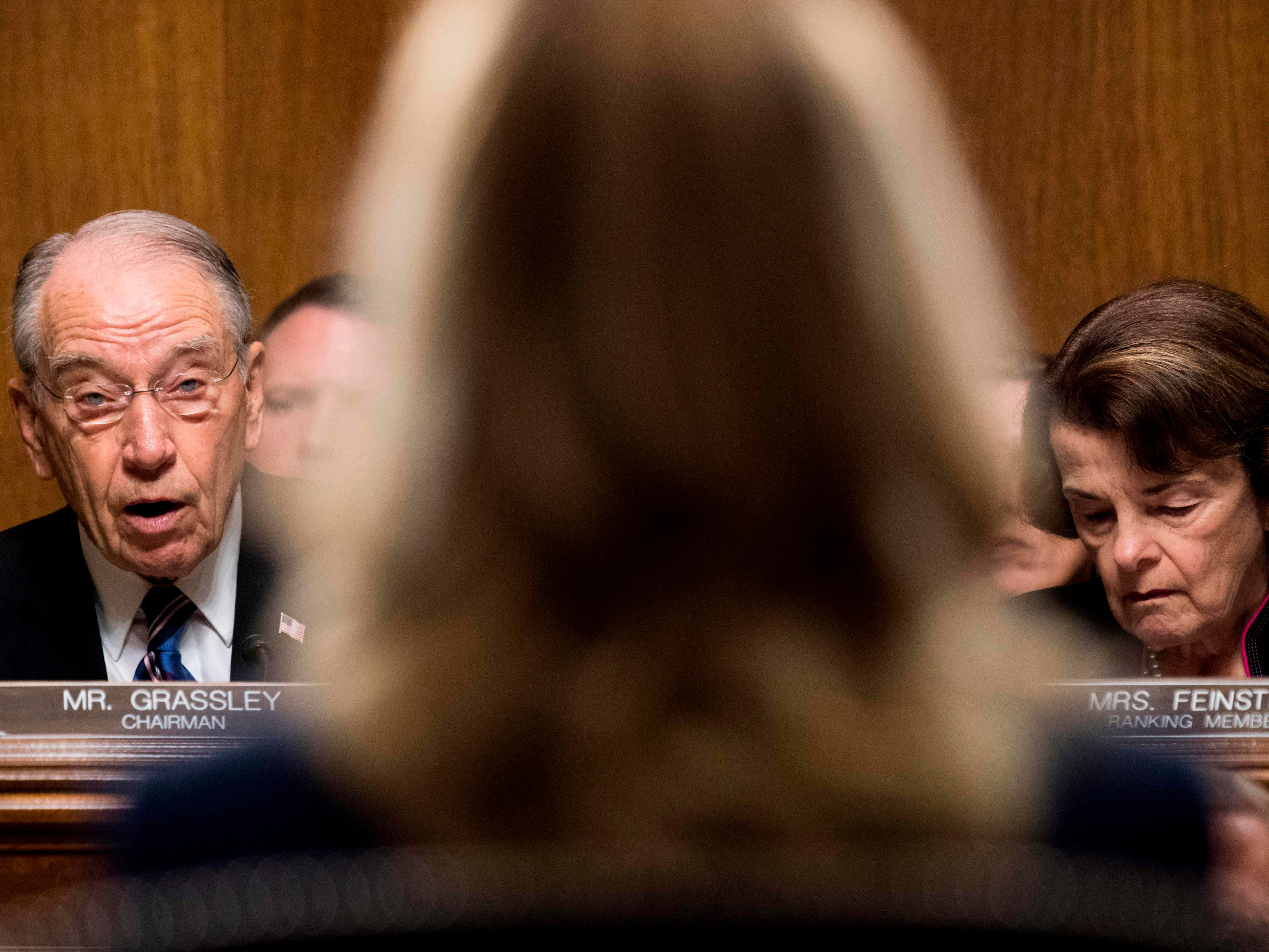 Senate Judiciary Committee chairman Charles Grassley (L), with Senator Dianne Feinstein (R), gives a preliminary statement before Christine Blasey Ford (C), the woman accusing Supreme Court nominee Brett Kavanaugh of sexually assaulting her at a party 36 years ago, testifies on Capitol Hill in Washington, DC, September 27, 2018. (Photo by Tom Williams / POOL / AFP)TOM WILLIAMS/AFP/Getty Images ORIG FILE ID: AFP_19I48A
