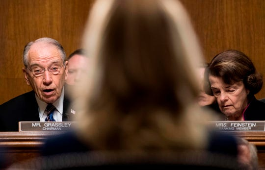 Senate Judiciary Committee chairman Charles Grassley (L), with Senator Dianne Feinstein (R), gives a preliminary statement before Christine Blasey Ford (C) testifies.