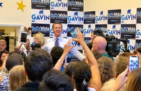 California's Democratic candidate for governor, Gavin Newsom (with his wife Jennifer to his right), stops in Berkeley, California, to help support the assembly bid of Buffy Wicks, who was an integral part of President Obama's grassroots electoral victory.