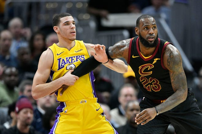 Lakers guard Lonzo Ball, shown here against LeBron James during a 2017 game, says he's not nervous to play with the man he long has admired.