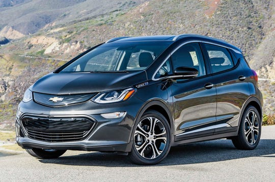 This undated photo provided by GM shows the 2019 Chevrolet Bolt, an electric car that gets 238 miles of range on a charge. (Jessica Lynn Walker/GM via AP)