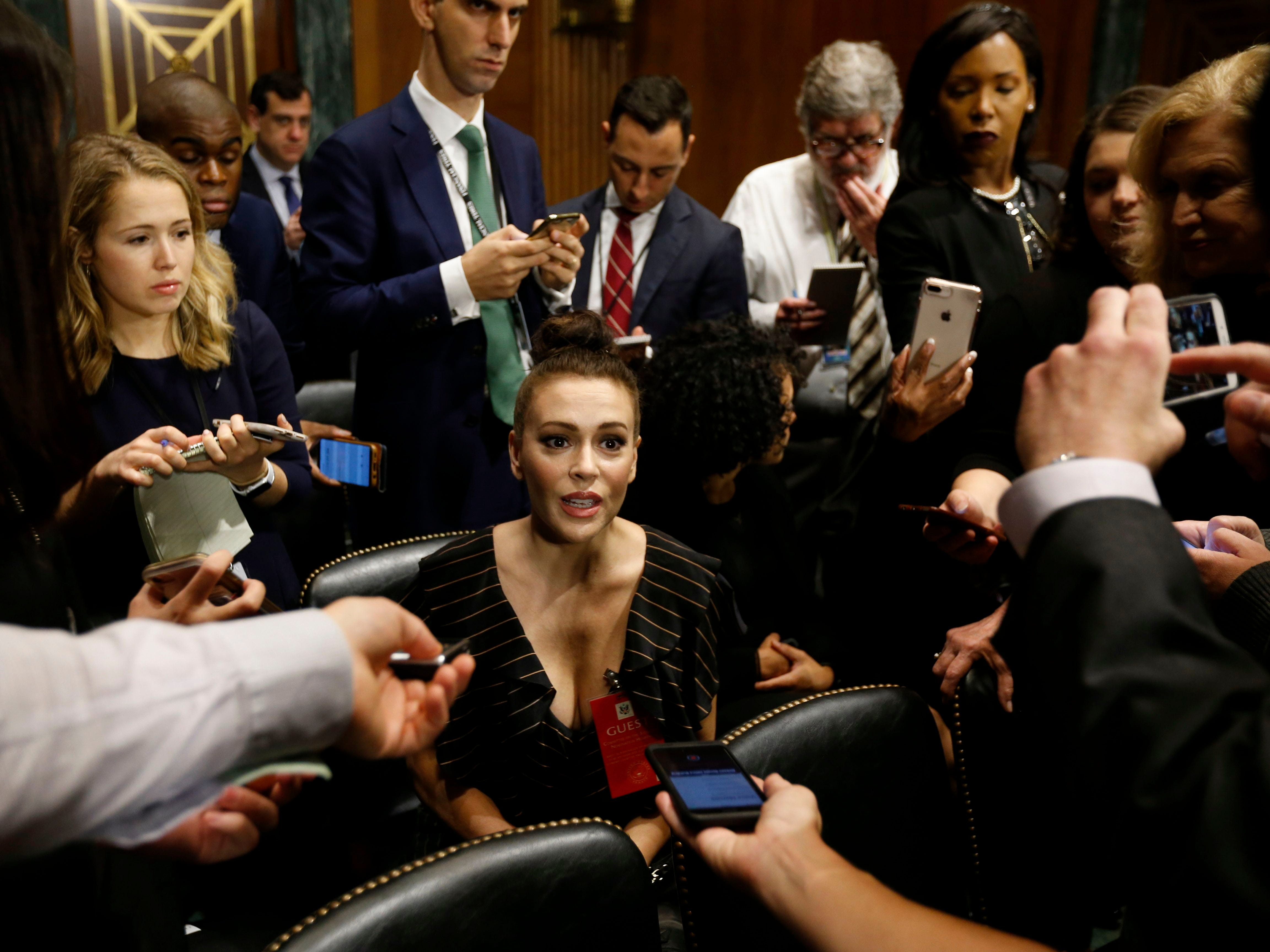 Actress Alyssa Milano talks to media before the Senate Judiciary Committee hearing on the nomination of Brett Kavanaugh to be an associate justice of the Supreme Court of the US in Washington, DC, on September 27, 2018. - Washington was bracing Thursday for a charged hearing pitting Donald Trump's Supreme Court pick Brett Kavanaugh against his accuser Christine Blasey Ford, who is set to detail sexual assault allegations against the judge that could derail his already turbulent confirmation process. (Photo by MICHAEL REYNOLDS / POOL / AFP)MICHAEL REYNOLDS/AFP/Getty Images ORG XMIT: Christine ORIG FILE ID: AFP_19I3BJ