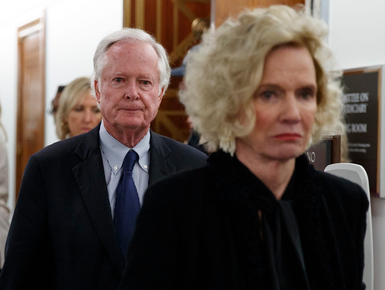 Judge Brett Kavanaugh's parents, Edward Kavanaugh and Martha Kavanaugh, walk from the hearing room during a break in a Senate Judiciary Committee hearing on Capitol Hill.