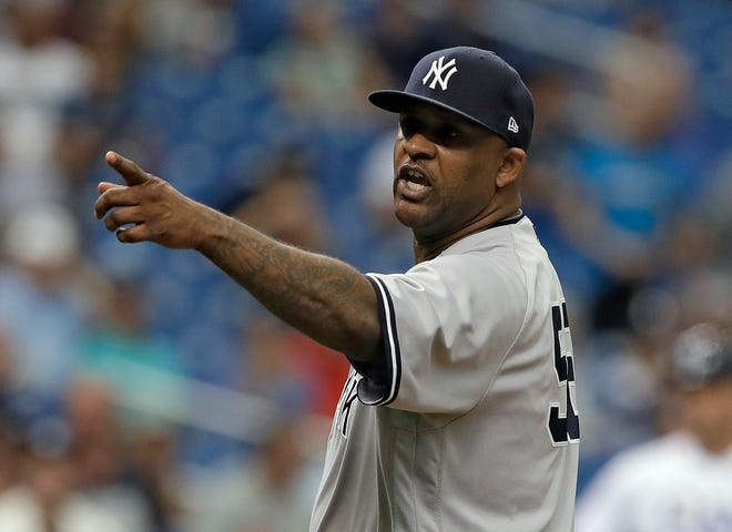 CC Sabathia points at the Tampa Bay Rays dugout after he was ejected for hitting Tampa Bay's Jesus Sucre during the sixth inning of Thursday's game.