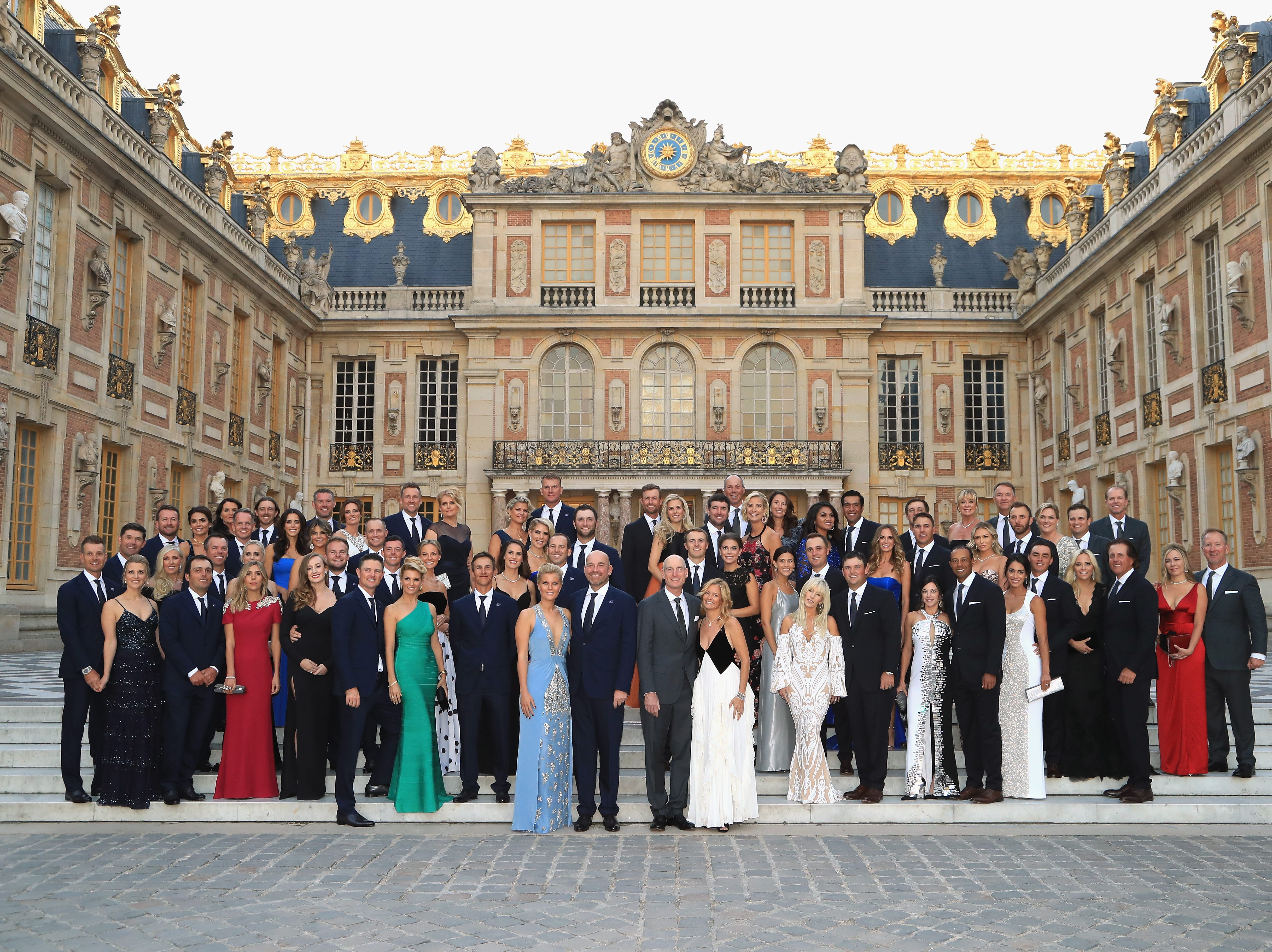The players of Team Europe and Team USA pose with their partners on the steps of the Palace of Versailles prior to the Ryder Cup gala Sept. 26.