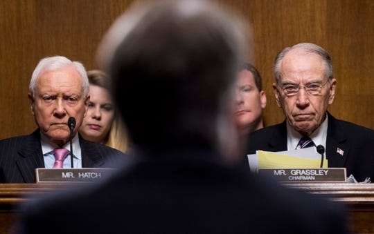 Sen. Orrin Hatch, R-Utah, left, and Sen. Chuck Grassley, R-Iowa, listen as Judge Brett Kavanaugh testifies during the Senate Judiciary Committee hearing on his nomination to be an associate justice of the Supreme Court.