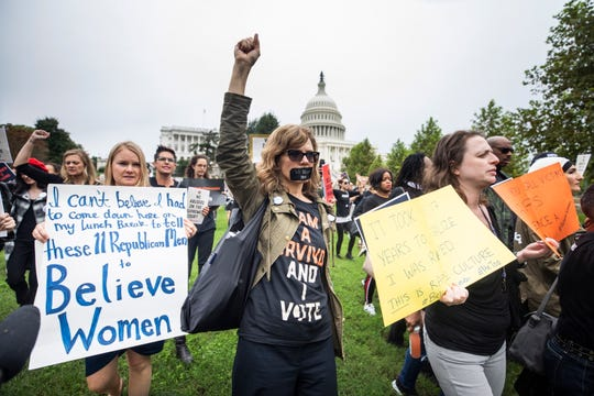 Protestors gather outside the US Capitol as Supreme Court nominee Brett Kavanaugh and Christine Blasey Ford, one of the women accusing him of sexual assault, testify on Capitol Hill.