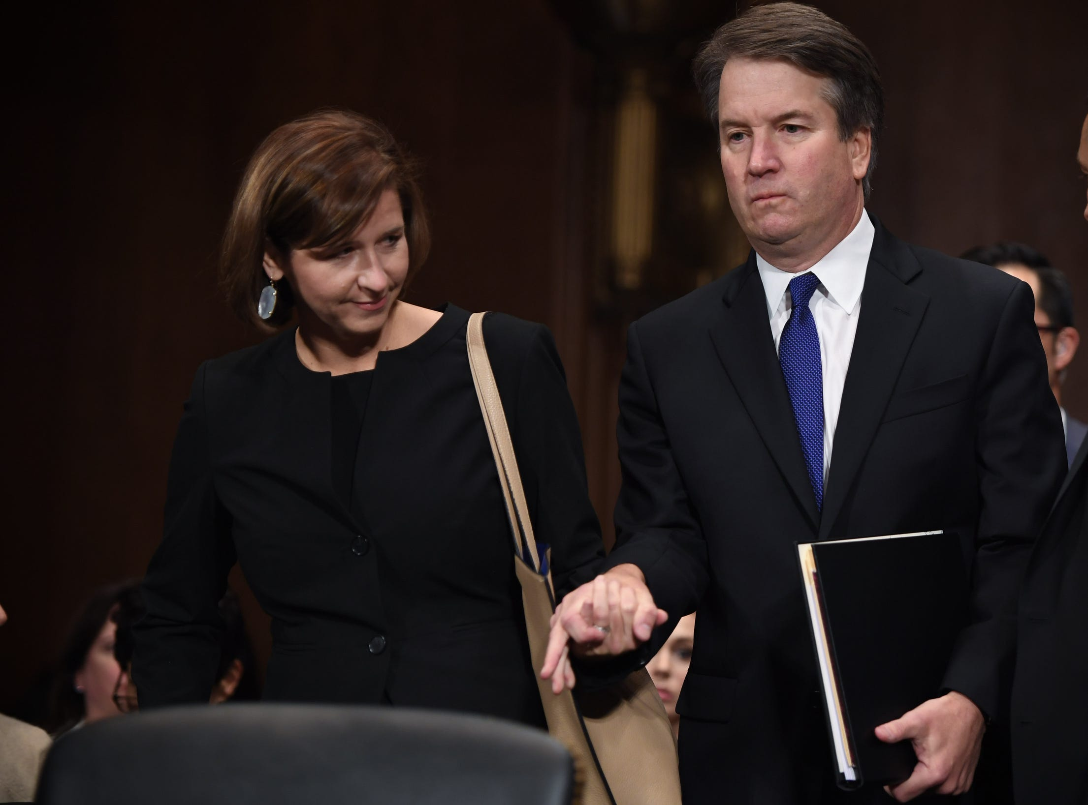 Supreme Court nominee Judge Brett Kavanaugh (R) arrives with his wife Ashley to testify, Thursday, before the US Senate Judiciary Committee in the Dirksen Senate Office Building, in Washington, DC.
