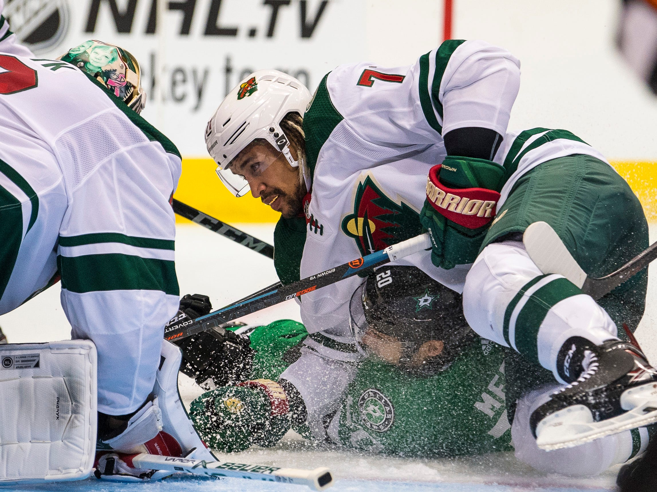 Sept. 24: Minnesota Wild right wing J.T. Brown takes down Dallas Stars left wing Michael Mersch.