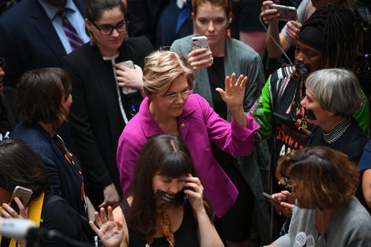 Senator Elizabeth Warren (D-MA) shaking hands with people protesting in the Hart Senate Office Buildings before Christine Blasey Ford testifies in front of the Senate Committee on the Judiciary on Sept. 27, 2018 in Washington.