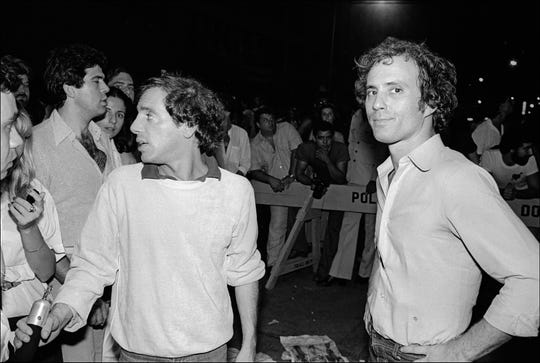 Steve Rubell (left) and Ian Schrager stand before the crowds at Studio 54.
