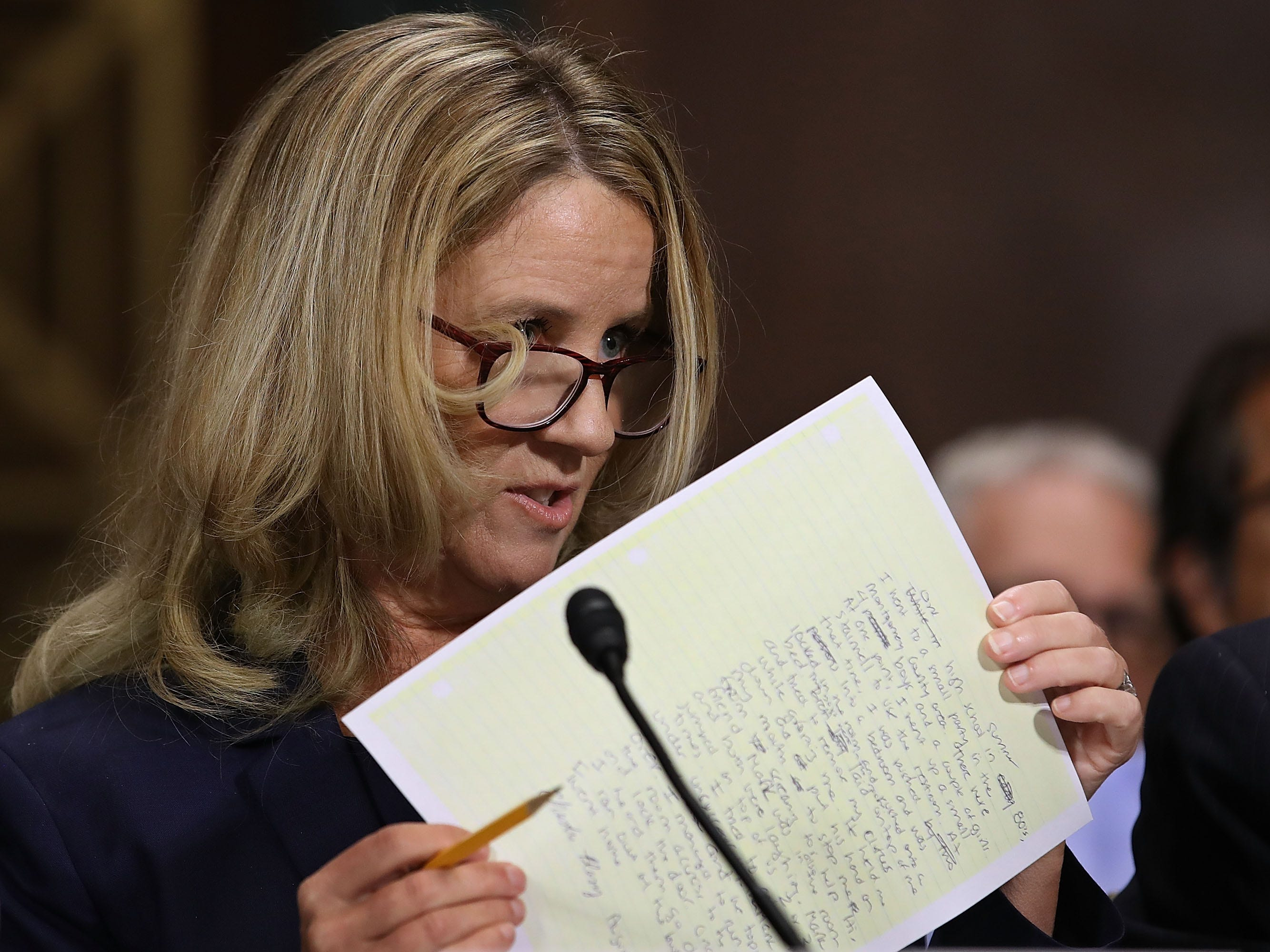 Christine Blasey Ford holds notes as she testifies before the Senate Judiciary Committee in the Dirksen Senate Office Building on Capitol Hill September 27, 2018 in Washington, DC. (Photo by Win McNamee / POOL / Getty Images)WIN MCNAMEE/AFP/Getty Images ORG XMIT: 775234142 ORIG FILE ID: AFP_19I54A