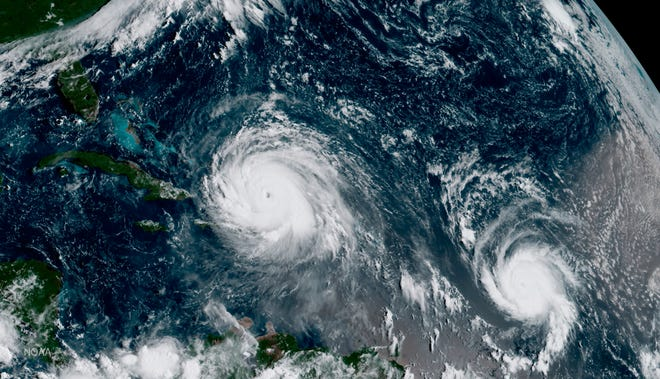 A Sept. 7, 2017, satellite image from NOAA shows the eye of Hurricane Irma, left, just north of the island of Hispaniola, with Hurricane Jose, right, in the Atlantic Ocean. Six major hurricanes formed in the Atlantic in 2017, including Harvey, Irma and Maria.