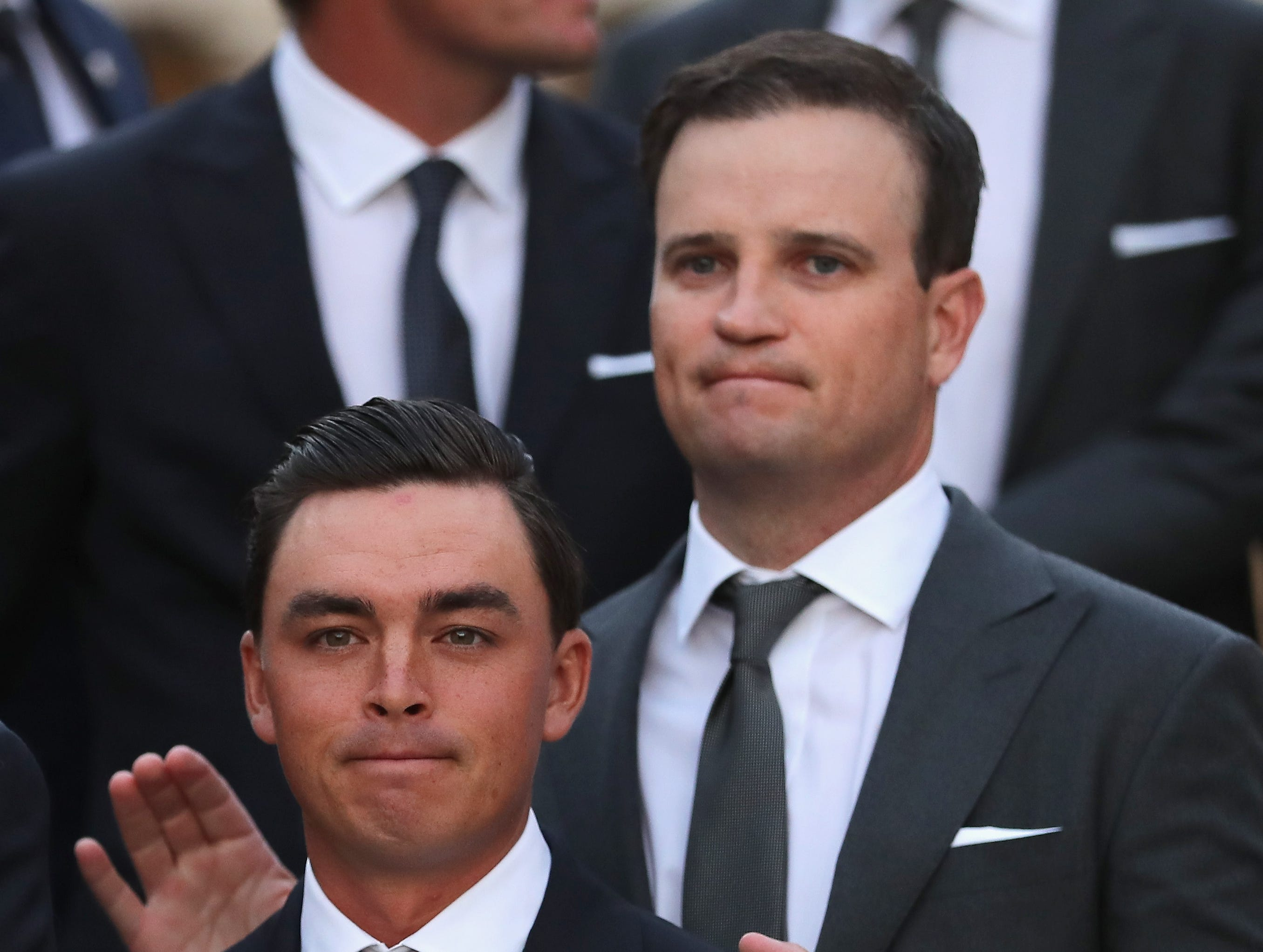 Rickie Fowler (L) and vice-captain Zach Johnson (R) of the United States attend the Ryder Cup gala Sept. 26.