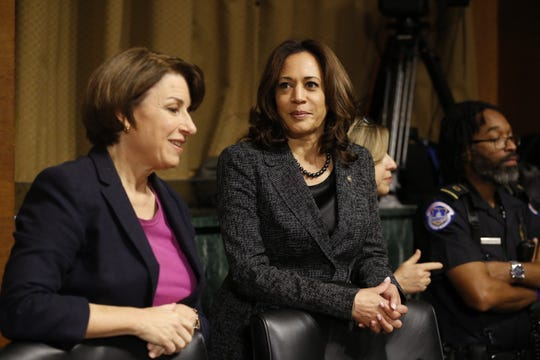 Sens Amy Klobuchar (D-MN) and Kamala Harris (D-CA) speak before the Senate Judiciary Committee hearing on the nomination of Brett Kavanaugh to the Supreme Court, on Capitol Hill in Washington, September 27, 2018.