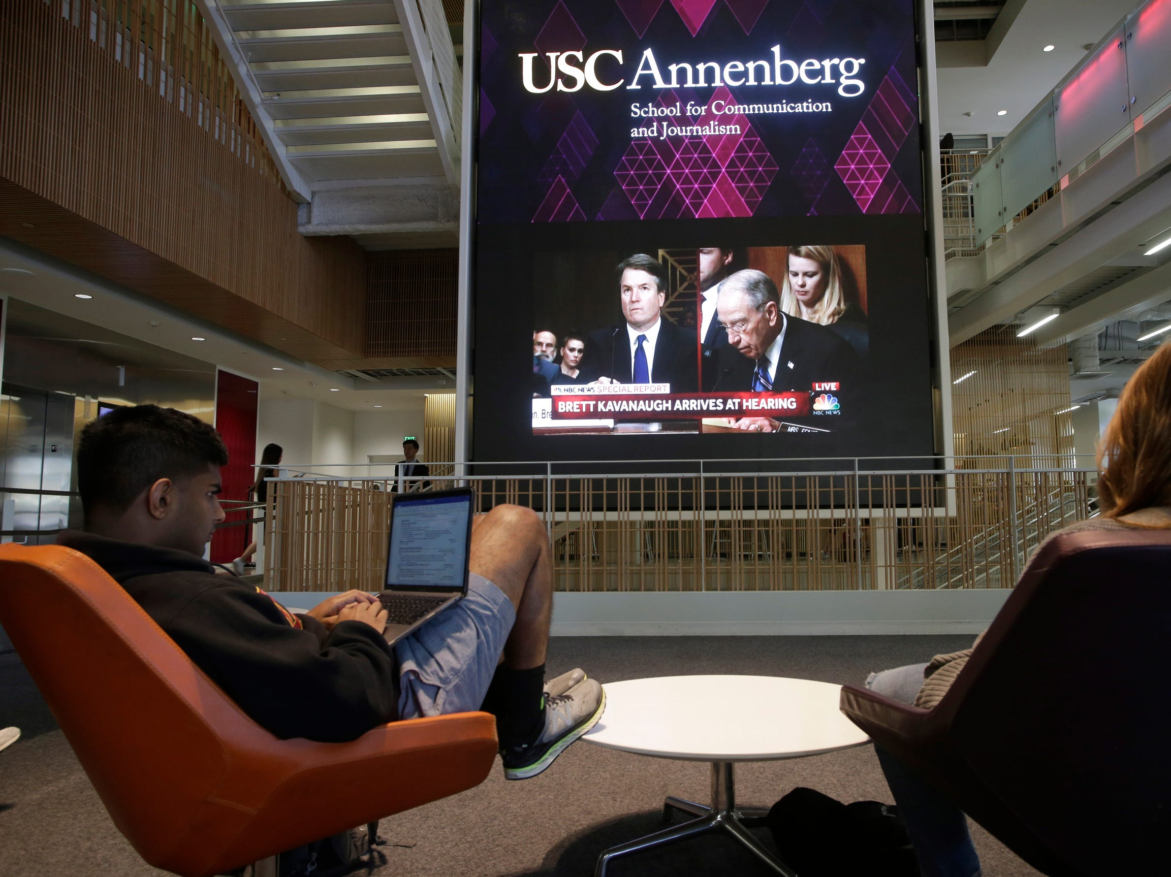 Students at the University of Southern California (USC) watch a live telecast of the testimony from Brett Kavanaugh over sexual assault allegations from Christine Blasey Ford, Sept. 27, 2018, at the Annenberg School for Communications and Journalism in Los Angeles.