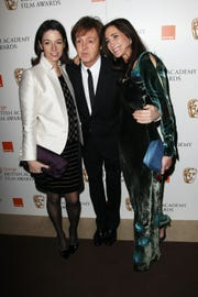 Nancy Shevell, Mary McCartney and Paul McCartney arrive at the British Academy Film Awards 2011 at The Royal Opera House on Feb. 13, 2011 in London.
