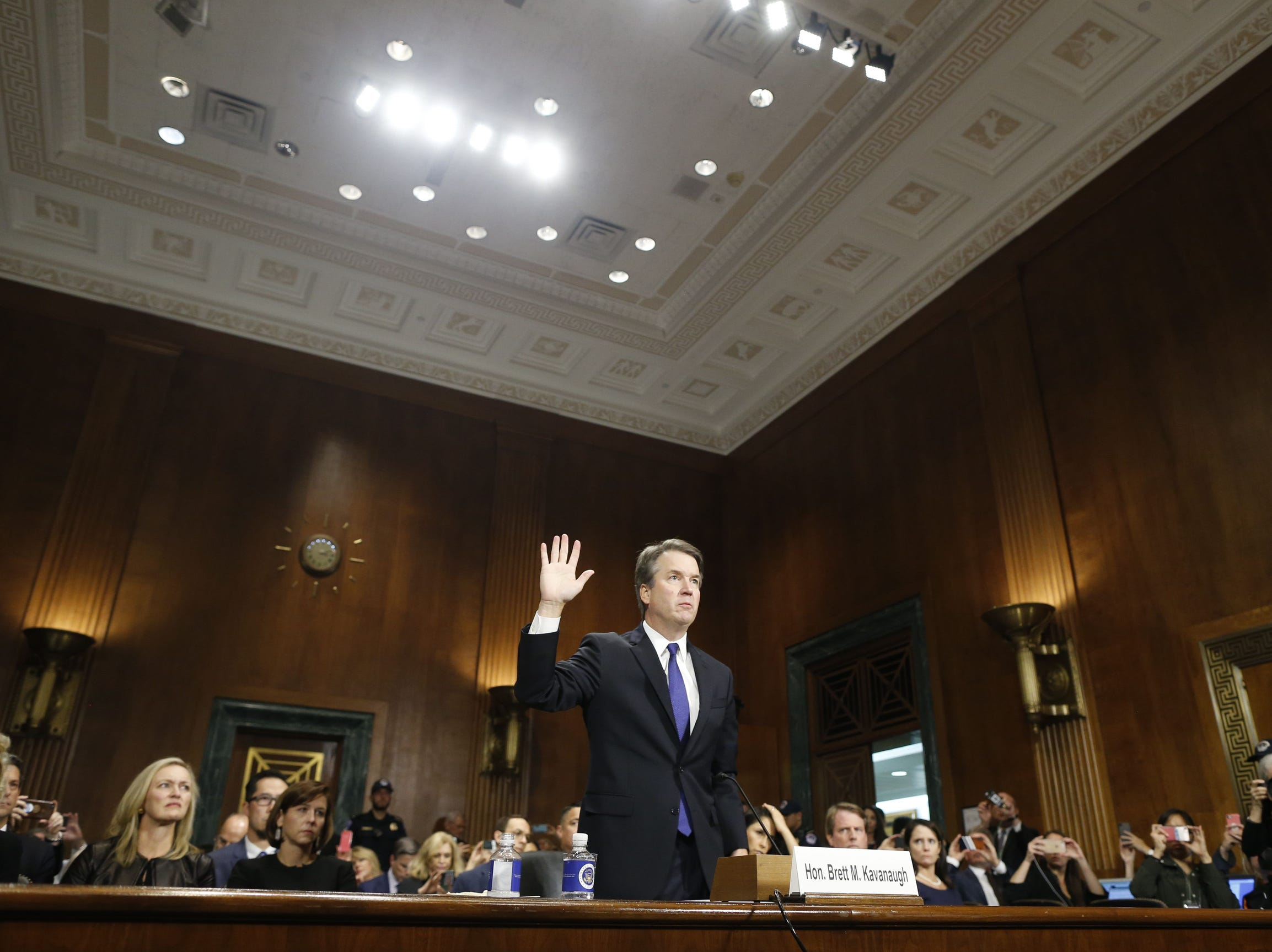 US Supreme Court nominee Judge Brett Kavanaugh is sworn in before testifying at the Senate Judiciary Committee on Capitol Hill, Thursday.
