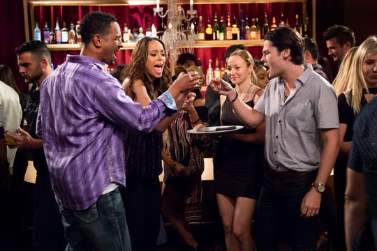 "Damon Wayans Jr., Amber Stevens West and Felix Mallard in ""Happy Together."""
