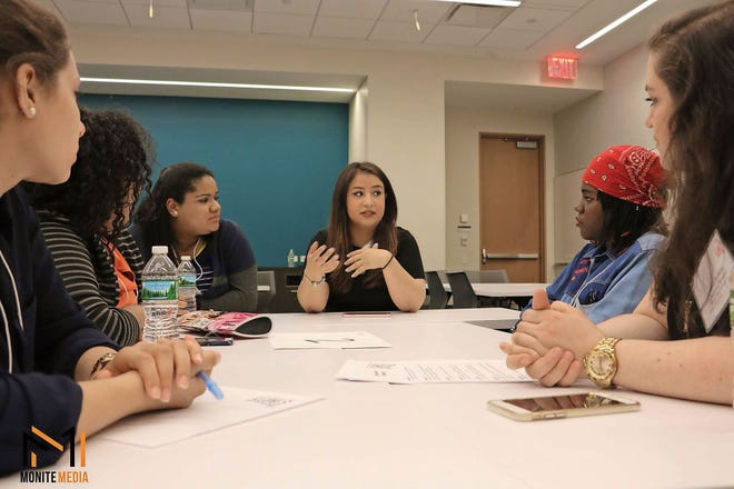 Dior Vargas (center) is working to break down mental health stereotypes.