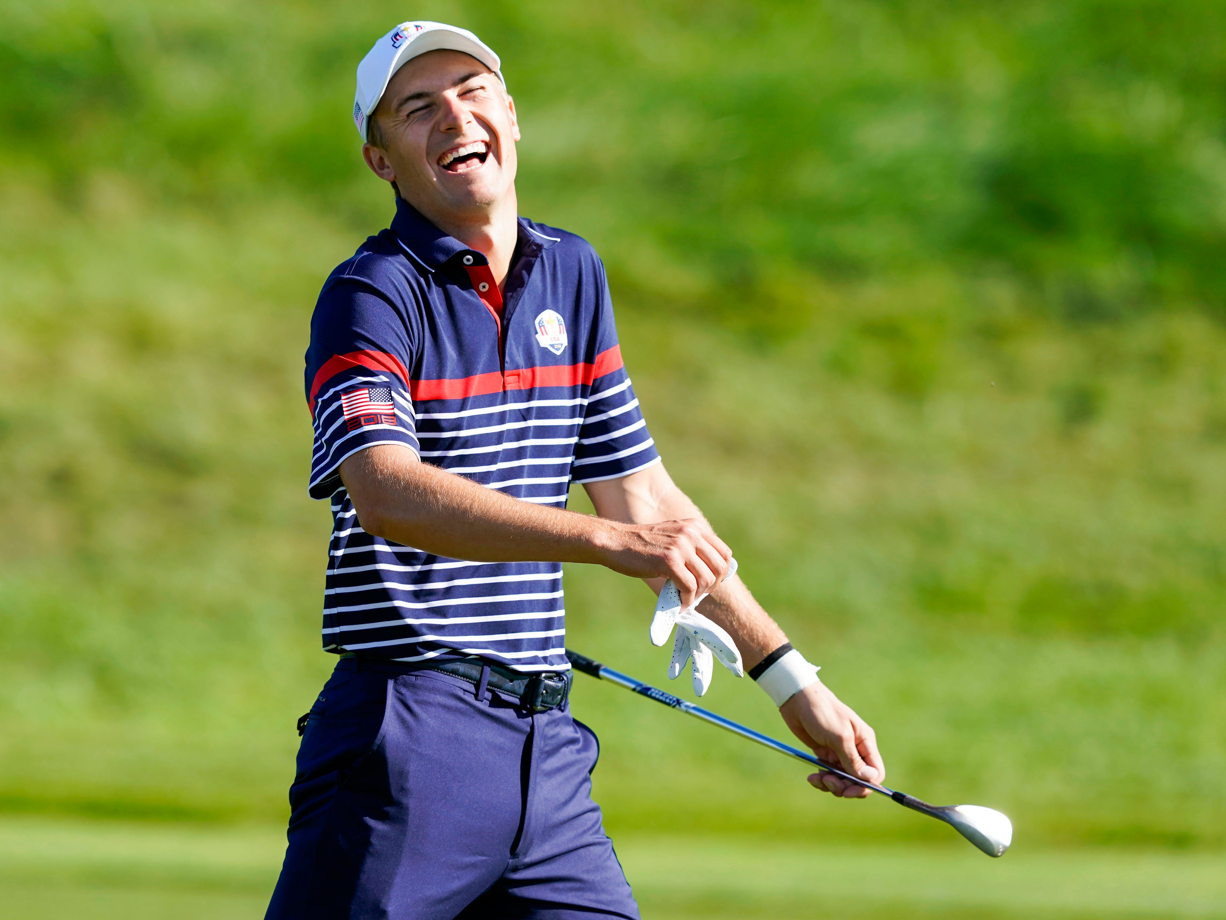 Jordan Spieth laughs during a Ryder Cup practice round at Le Golf National.