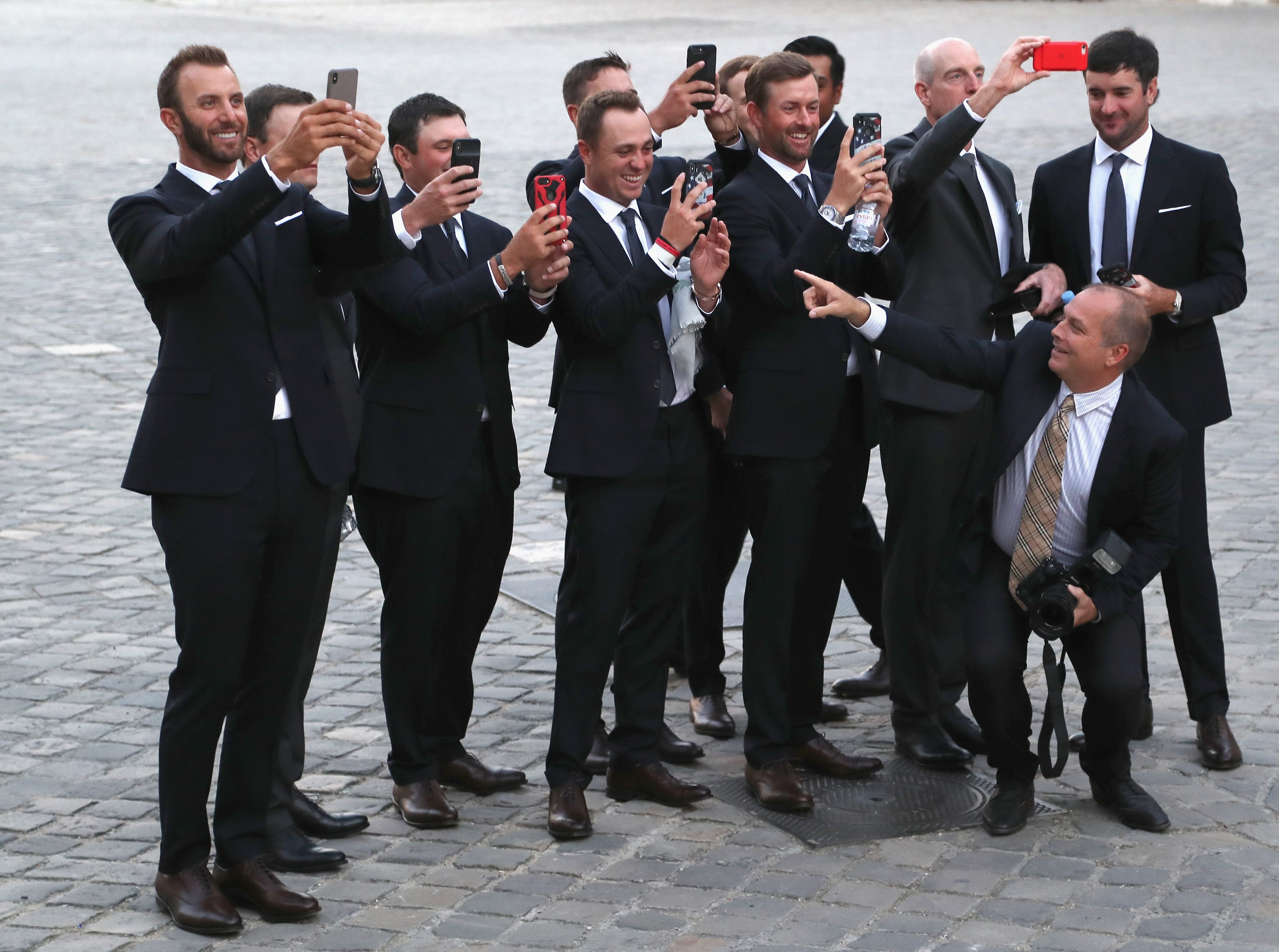 Players take pictures of their wives and partners before the Ryder Cup gala.