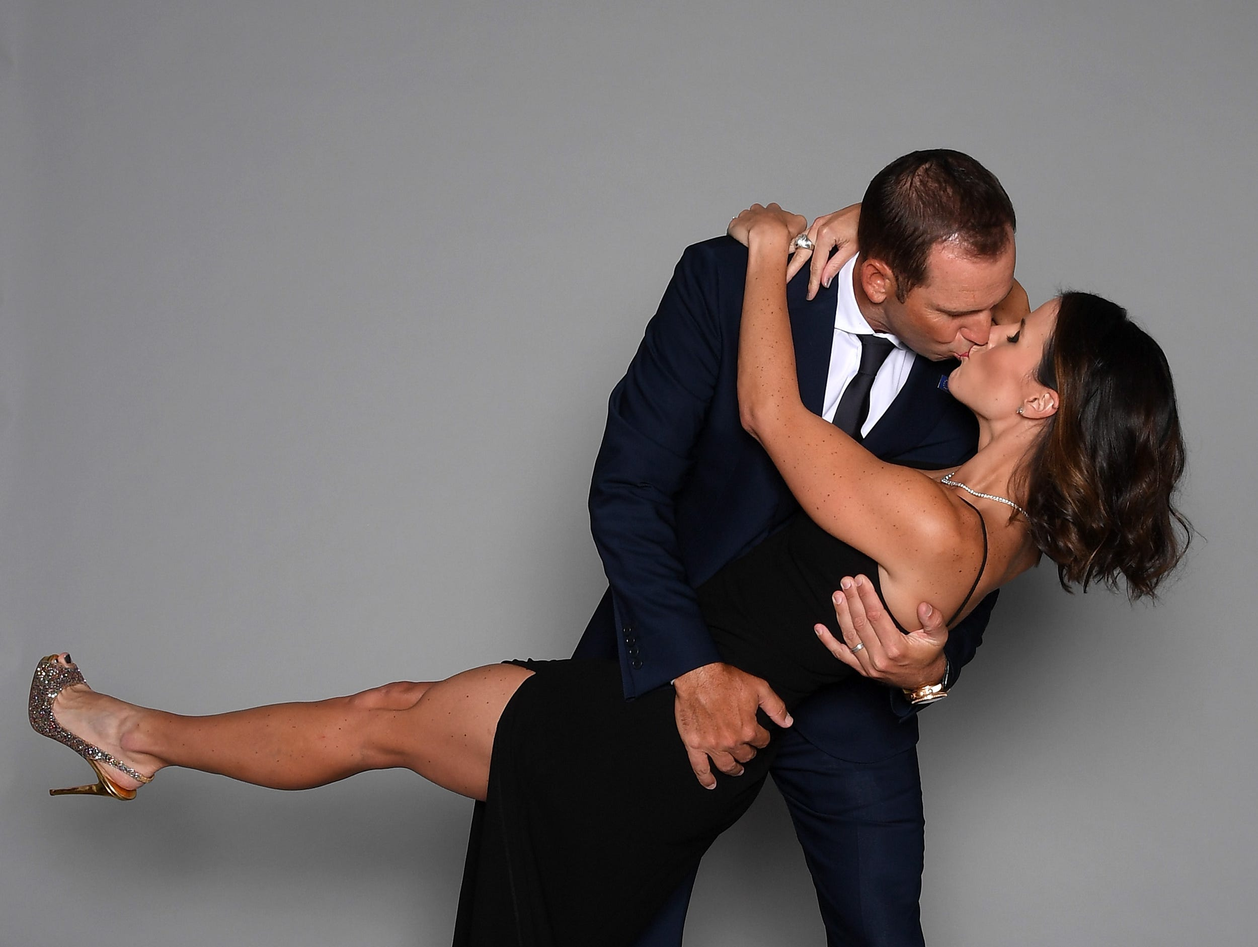 Sergio Garcia of Europe and wife Angela Garcia share a kiss in a portrait before the Ryder Cup gala.