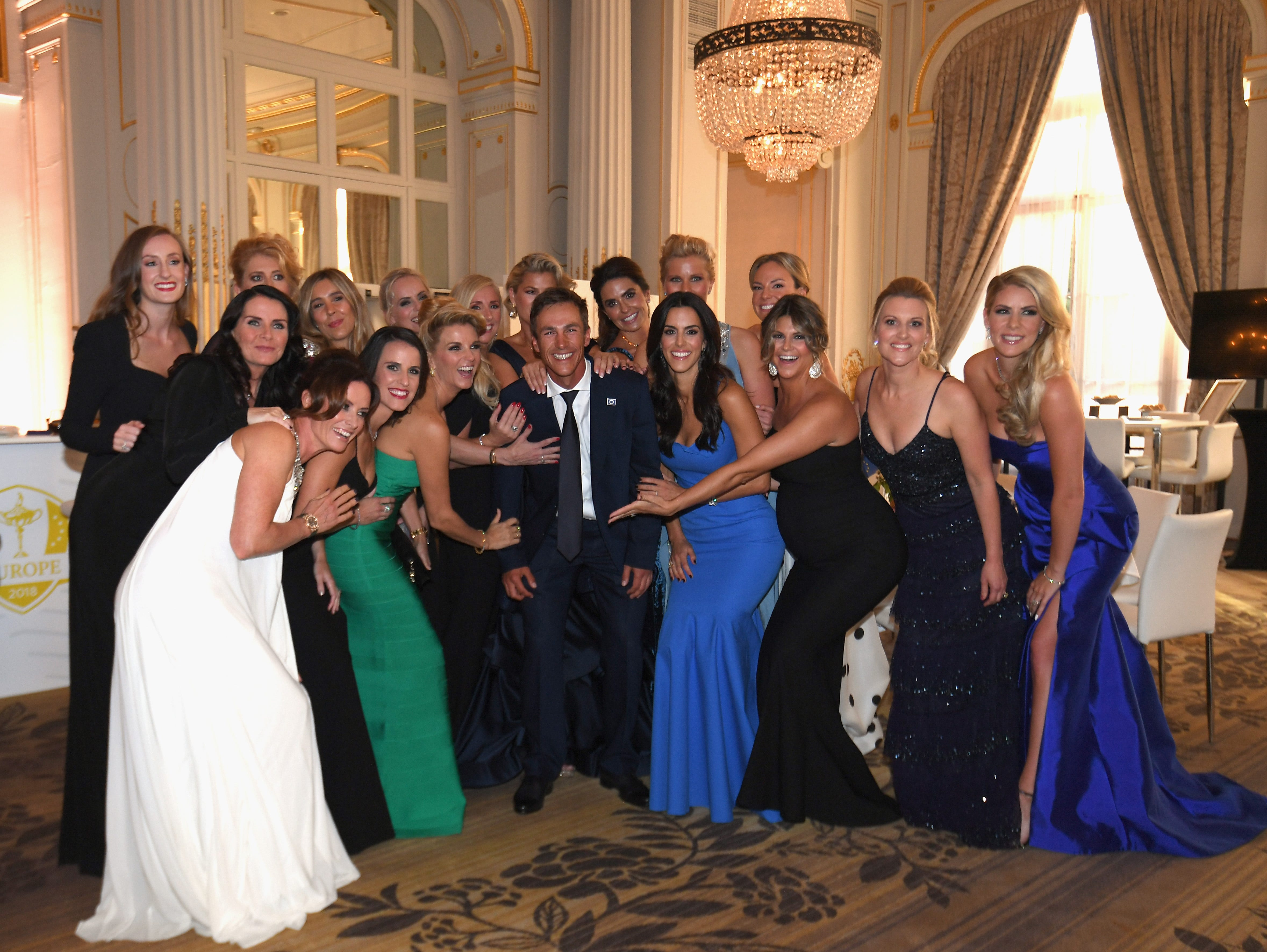 Thorbjorn Olesen of Europe poses with player's wives and partners prior to the 2018 Ryder Cup gala.