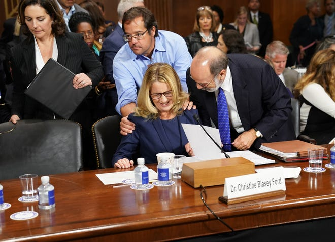 Christine Blasey Ford takes a break from testifying at a U.S. Senate Judiciary Committee hearing Sept. 27, 2018.