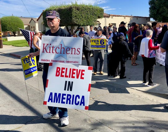 Bill Harris protests the arrival of Democratic gubernatorial candidate Gavin Newsom at a campaign stop in Salinas, California, an agricultural region that is home to many conservative voters.