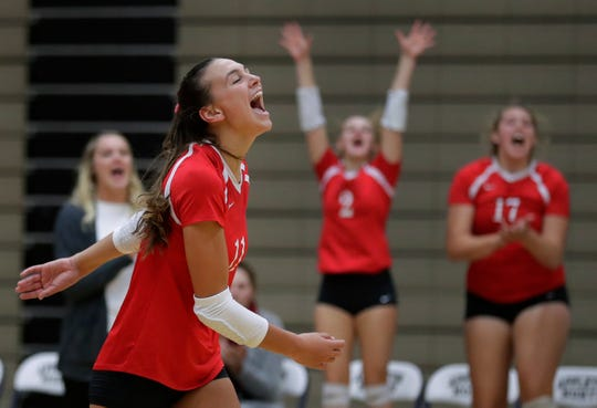 Kimberly High School's Maggie Cartwright celebrates winning a point against Appleton North High School during a girls volleyball match earlier this year.