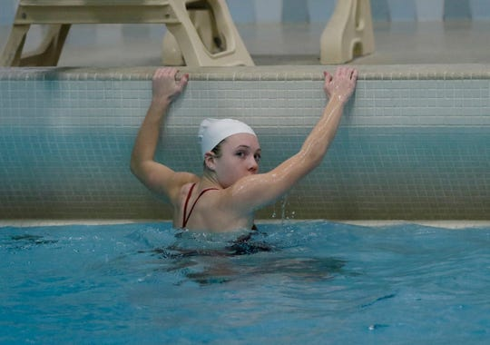 Neenah's Av Osero looks at the scoreboard after completing a dive during the WIAA Division 1 Girls State Swimming and Diving Championships last November in Madison.