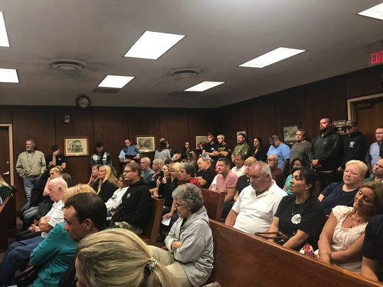 More than 100 spectators gathers at Lacey's municipal building to show their support for Caffrey's Tavern owners.