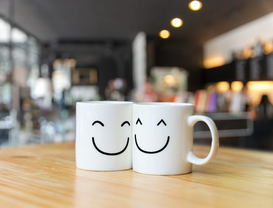 Two happy cups of coffee