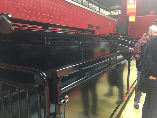 """The new """"loge"""" seating is being built along the baseline in Section 118"""