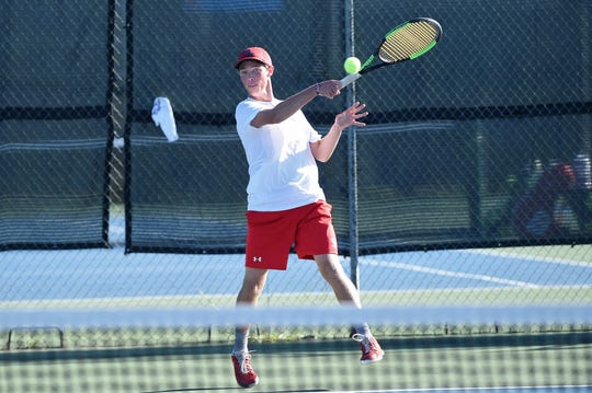Cooper's Michael Scarborough follows through on a shot while playing No. 3 boys singles on Thursday.