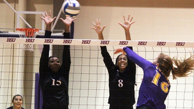 McMurry's Jordyn Burnell (8) and Justice McGowen (15) attempt to block Hardin-Simmons' Kaitlynn Lewis.