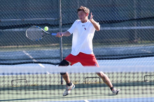 Cooper's Aaron Hines hits a shot at No. 1 singles against a Wylie player on Sept. 27, 2018. Hines will play tennis at  McMurry in the  fall.