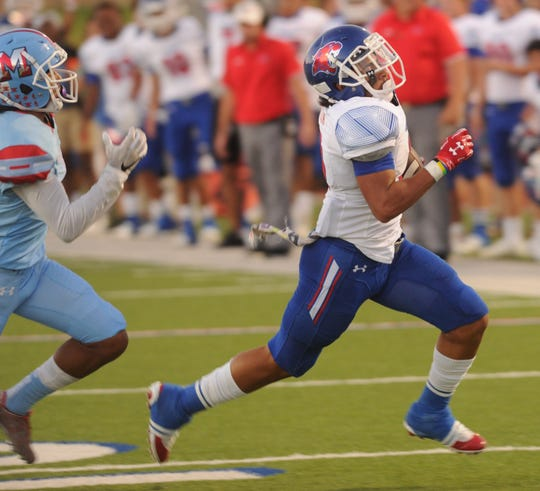 Cooper's Noah Garcia eludes a Lubbock Monterey defender in the first quarter. Garcia ran for 243 yards, including a TD, in the Cougars' 58-20 victory over Monterey in the District 2-5A Division I opener Thursday, Sept. 27, 2018 at Lowrey Field in Lubbock.