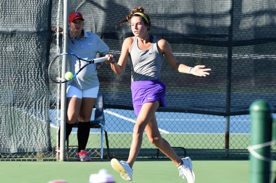 Wylie's Madison Andrews hits a shot at No. 3 singles against Cooper. Andrews won 6-0, 6-0.
