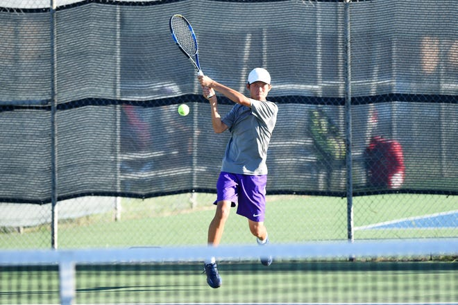 Wylie's Anthony Zhang follows through on a shot at No. 6 singles against Cooper on Thursday. Zhang won 6-0, 6-0 as Wylie beat Cooper 18-1.