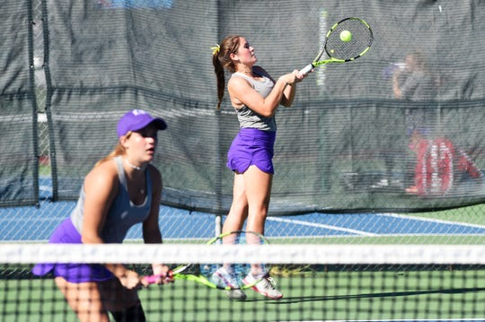 Wylie's Rebecca Yates hits a shot behind No. 3 girls doubles partner Hailey Parker against Cooper. Yates and Parker won 6-1, 6-1 as Wylie won the match 18-1.