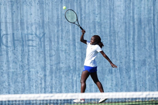 Cooper's Josephine Bandora hits a shot during No. 2 girls doubles against Wylie.