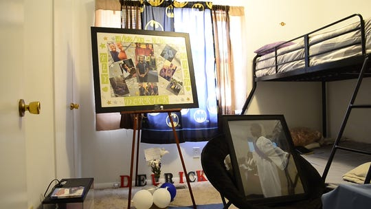 Photos of Derrick LaQuinn Lee Jr. in his bedroom at his grandparents' home. Lee, 12, was killed in a drive-by shooting in July.