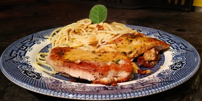 Pork chops with cider cream sauce is a simple fall dish that satisfies.