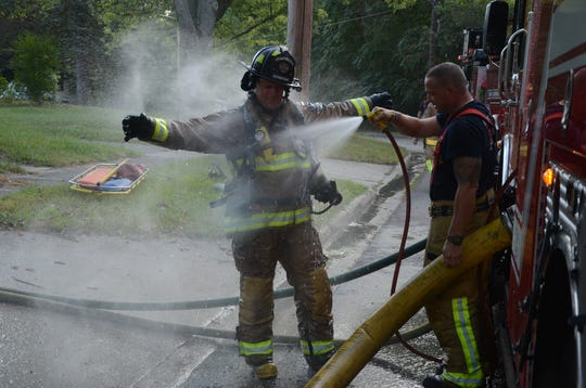 Firefighters were decontaminated with clean water after fighting the fire inside the home.