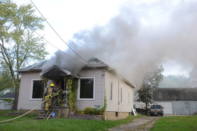 Heavy smoke pours from a home at 71 Fairview Avenue in Battle Creek.