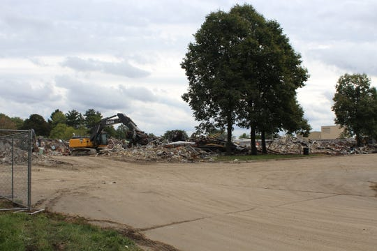 The State Farm building was vacant since 2005. The Calhoun County Land Bank Authority is currently demolishing the building.