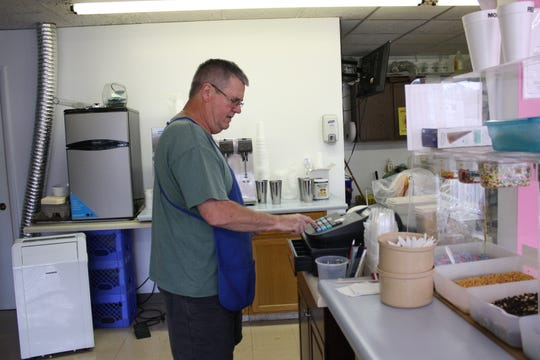 Custard Corner owner Fred Corl, 67, enters a purchase into his cash register on Sept. 27.